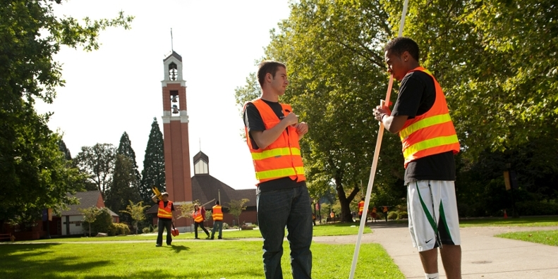 Two students surveying campus landmarks.