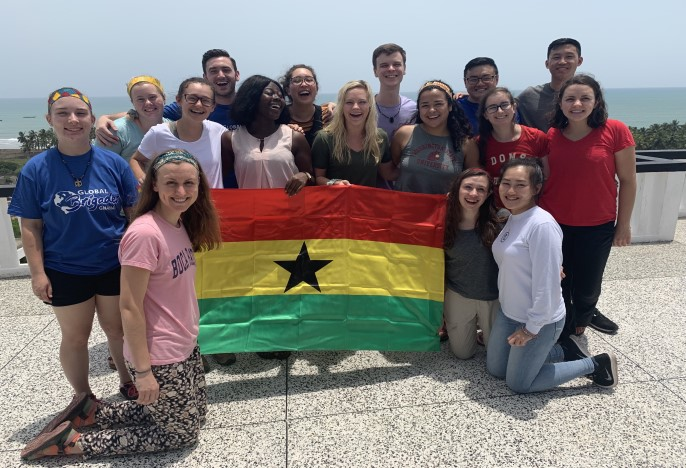 Group of students in Ghana with flag