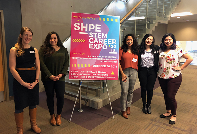 SHPE team with poster