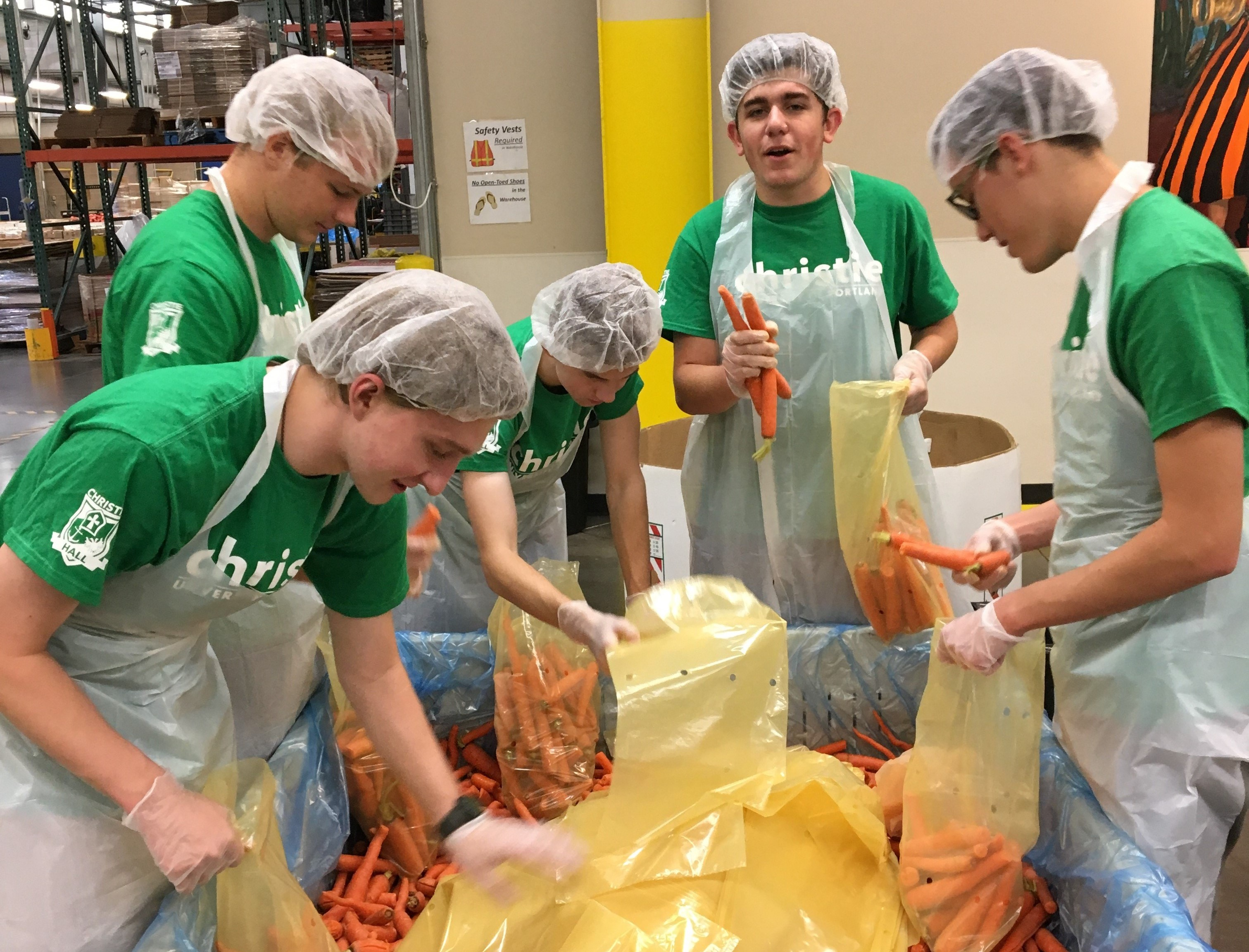 Christie Hall Men sorting carrots for Oregon Food Bank